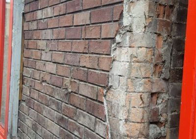 Brick cladding adhered to victorian brickwork with cement base grout