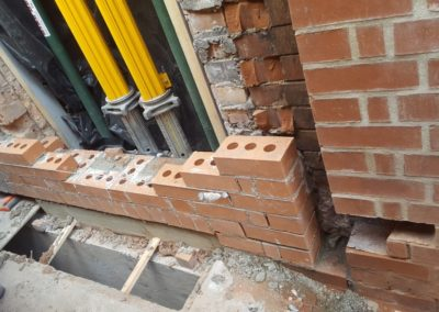 Rebuilding base of window and tying it in to match existing brickwork and bond with lime mortar